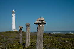 Stones stacked on top of an old fence near Slangkop light house in Kommetjie, Cape Town, Thursday, July 17, 2020. PHOTO: EVA-LOTTA JANSSON