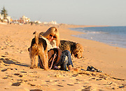 EXCLUSIVE<br /> Kellie Maloney, former Frank maloney boxing promoter, takes a walk with her two dogs at Faro Beach, the day after celebrating  its sixty-second birthday at The Irish Pub in Vilamoura Marina, Portugal.<br /> Kellie take some time out in Portugal before she is due her gender operation in Feb, Frank was better known for being the manager of Boxing Champion  Lennox Lewis <br /> ©Exclusivepix Media
