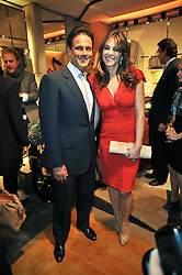 ELIZABETH HURLEY and ARUN NAYAR at a party to launch the book 'Italian Touch' - A Celebration of Italian Lifestyle held at TOD's, 2-5 Old Bond Street, London on 4th November 2009.