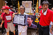 28 APRIL 2014 - BANGKOK, THAILAND: A procession honoring Kamol Duangphasuk, 45, during his funeral in Bangkok. Kamol was a popular poet who wrote under the pen name Mai Nueng Kor Kunthee. Kamol had been writing since the 1980s and was an outspoken critic of the 2006 coup that deposed Thaksin Shinawatra. After the 2010 military crackdown against the Red Shirts he went into temporary self imposed exile fearing for his safety. After he returned to Thailand he organized weekly protests against Thailand's Lese Majeste laws, which he said were being used to stifle dissent. Kamol was shot and murdered on April 23. The assailants are still at large but the murder is thought to be political.     PHOTO BY JACK KURTZ
