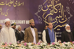 December 12, 2016 - Lahore, Punjab, Pakistan - Prime Minister of Pakistan Mian Muhammad Nawaz Sharif and Turkish Head of the Religious Affairs Directorate, Mehmet Gormez (L), Federal Minister for Religious Affairs & Interfaith Harmony Sardar Muhammad Yousaf attends Seerat Conference, a special prayer organization organized within the celebration for Mawlid al-Nabi, birth anniversary of Muslims' beloved Prophet Mohammad in Lahore. (Credit Image: © Rana Sajid Hussain/Pacific Press via ZUMA Wire)