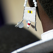 The beaded earring of a Maasai woman blows in a stiff savannah breeze in the Ngorongoro Conservation Area, Tanzania.