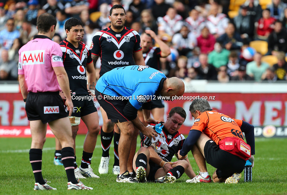 James Maloney of the Warriors recieves attention for a knee injury during the NRL game, Vodafone Warriors v Cronulla Sharks, Mt Smart Stadium, Auckland, Sunday 5 August  2012. Photo: Simon Watts /photosport.co.nz