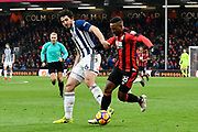 Jermain Defoe (18) of AFC Bournemouth on the attack with Ahmed Hegazi (26) of West Bromwich Albion close by during the Premier League match between Bournemouth and West Bromwich Albion at the Vitality Stadium, Bournemouth, England on 17 March 2018. Picture by Graham Hunt.
