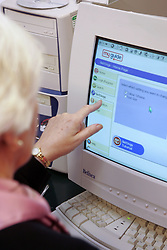 Older people using myguide; a website designed to help people take their first steps with computers and the internet 2010 UK