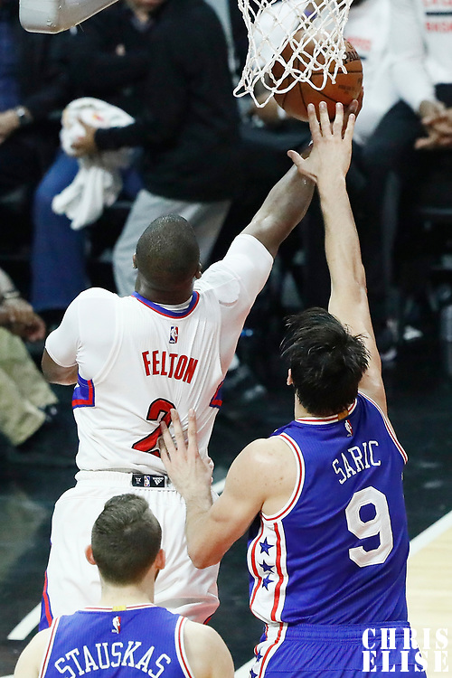 11 March 2017: LA Clippers guard Raymond Felton (2) goes for the reverse layup past Philadelphia 76ers forward Dario Saric (9) during the LA Clippers 112-100 victory over the Philadelphia Sixers, at the Staples Center, Los Angeles, California, USA.