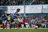 Photo: Lee Earle.<br /> Portsmouth v Sunderland. The Barclays Premiership. 22/04/2006. Pompey's Matthew Taylor slots home from the penalty spot.