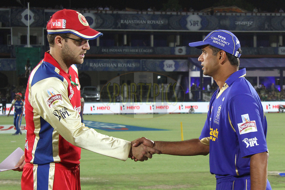 Royal Challengers Bangalore captain Daniel Vettori and Ajit Chandila of the Rajasthan Royals shake hands after the toss during match 30 of the the Indian Premier League (IPL) 2012  between The Rajasthan Royals and the Royal Challengers Bangalore held at the Sawai Mansingh Stadium in Jaipur on the 23rd April 2012..Photo by Shaun Roy/IPL/SPORTZPICS