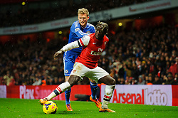 Arsenal Defender Bacary Sagna (FRA) is challenged by Chelsea Forward Andre Schurrle (GER) during the second half of the match - Photo mandatory by-line: Rogan Thomson/JMP - Tel: Mobile: 07966 386802 - 23/12/2013 - SPORT - FOOTBALL - Emirates Stadium - Arsenal v Chelsea - Barclays Premier League.