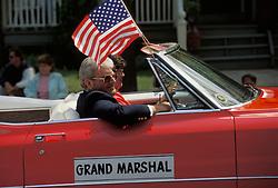 Americana Grand marshall car in  holiday celebration parade.