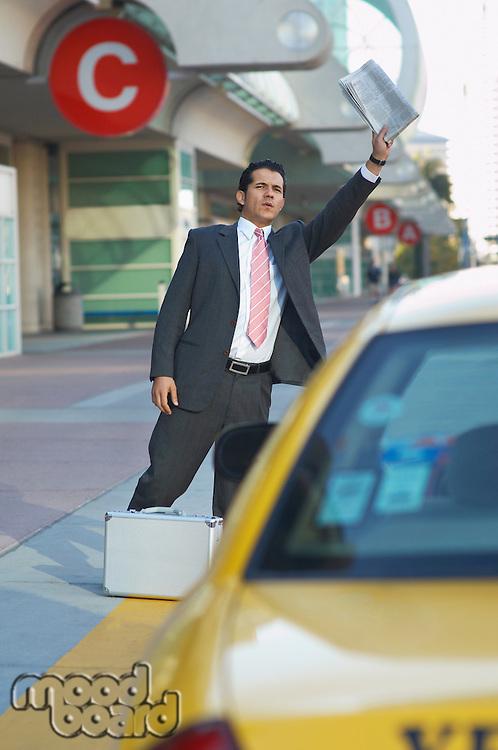Businessman hailing taxi