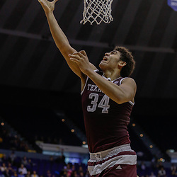 Feb 4, 2017; Baton Rouge, LA, USA; Texas A&M Aggies center Tyler Davis (34) shoots against the LSU Tigers during the first half at the Pete Maravich Assembly Center. Mandatory Credit: Derick E. Hingle-USA TODAY Sports