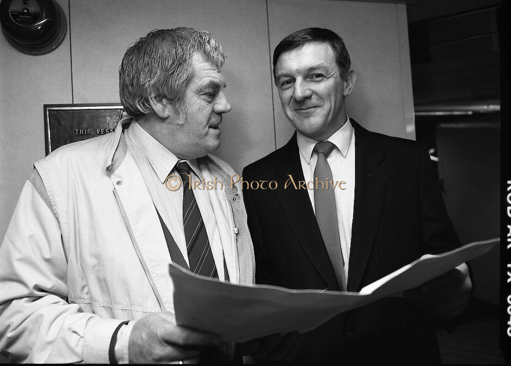 Big Tom McBride and Frank Burke.  (R75)..1988..16.03.1988..03.16.1988..16th March 1988..At the B & I ferryport in North Wall,Dublin a series of pictures of Big Tom McBride and Mr Frank Burke were taken...Image shows Tom McBride and Frank Burke reading a brochure in the B & I Ferryport.