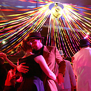 "Steven Stevenson and Sandra Morrow strut their stuff underneath the disco ball at the Century Ballroom during the prom-themed anniversary ball of the popular Capitol Hill business.  Photographed on Friday, Feb. 29, 2008 in Seattle.  (Photo/Seattle Post-Intelligencer/Joshua Trujillo)..This photo was for the first installment of our monthly Word photo feature.  Our editors pick a word and the photo staff has to interpret the word in a single photo.  The word last February was ""ball.""  So I went to a ballroom and photographed people dancing under the disco ball."