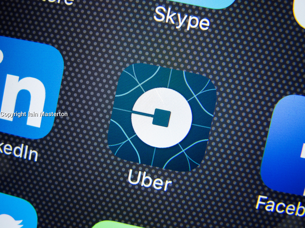 Uber online taxi booking new logo on app  on screen of iPhone 6 plus smart phone