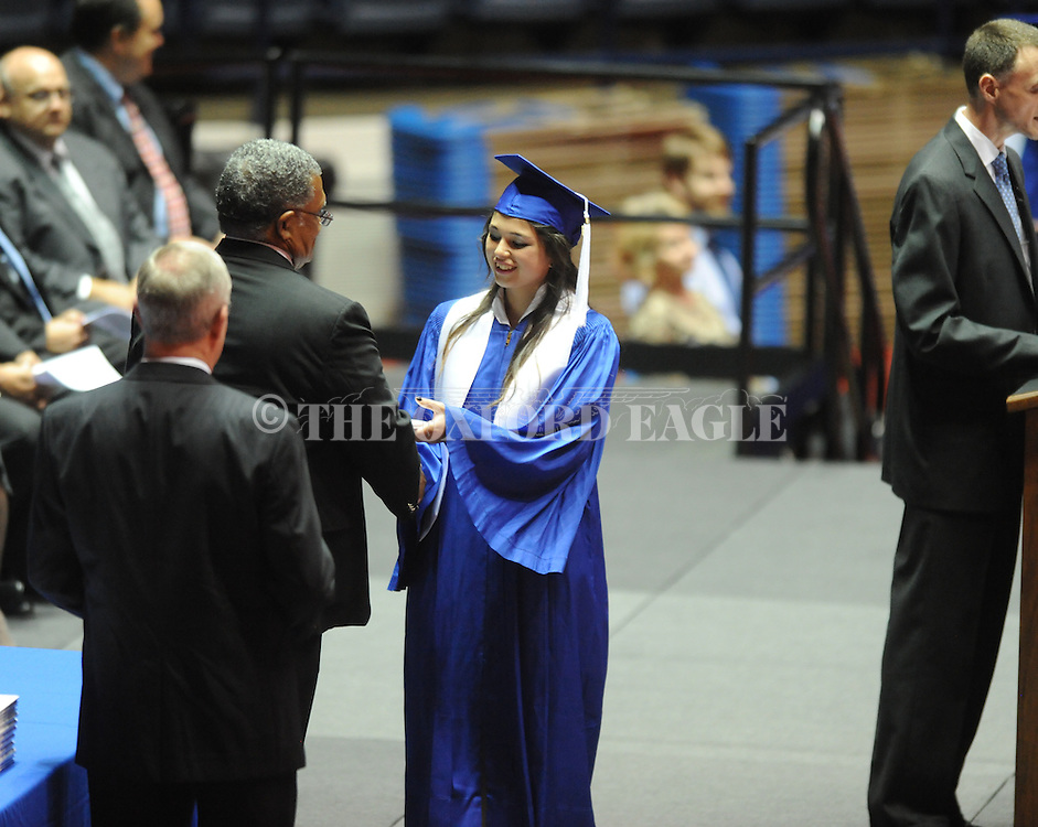 "Bethany Hernandez receives a diploma as Water Valley holds its graduation ceremony at the C.M. ""Tad"" Smith Coliseum in Oxford, Miss. on Thursday, May 23, 2013."