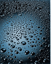 water drops on black shiny surface surface