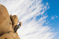 Woman Free Climbing on Rocks