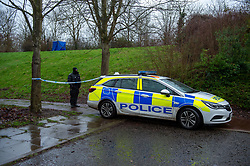 © Licensed to London News Pictures. 12/12/2019. Milton Keynes, UK. A forensic tent sits in a wooded area and a police officer maintains a cordon across a walkway access in the Fishermead area after a man was stabbed. Thames Valley Police has launched a murder investigation following the death of a man in Milton Keynes. Police and South Central Ambulance Service attended a woodland in Fishermead, Milton Keynes at around 15:20GMT on Wednesday 11th December 2019 after a report of an altercation between a group of men, during which a man had been stabbed. The victim, a man aged in his twenties died at the scene. Photo credit: Peter Manning/LNP