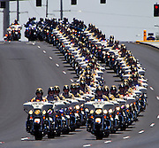 Metro Motorcycle Officers are joined by those from other area departments as they lead the body of slain Metro Officer Igor Soldo to the Palm Mortuary for funeral services .