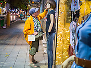 07 APRIL 2012 - HANOI, VIETNAM: A tourist looks at a mannequin on a street in Hanoi, the capital of Vietnam. Hanoi is one of the oldest cities in Southeast Asia. It was established in 1010 A.D.   PHOTO BY JACK KURTZ