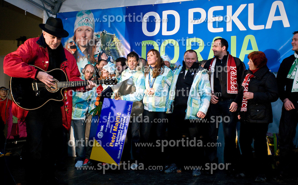 Slovenian bronze medalist cross-country skier Petra Majdic and her best singer Vlado Kreslin at reception at her home town Dol pri Ljubljani after she came from Vancouver after Winter Olympic games 2010, on March 1, 2010 in Dol pri Ljubljani, Slovenia. (Photo by Vid Ponikvar / Sportida)