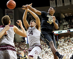 Vanderbilt's Damian Jones (30) fights for a rebound with Texas A&M's Tyler Davis (34) during the second half of an NCAA college basketball game, Saturday, March 5, 2016, in College Station, Texas. Texas A&M won 76-67. (AP Photo/Sam Craft)
