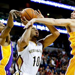 Nov 8, 2013; New Orleans, LA, USA;  New Orleans Pelicans shooting guard Eric Gordon (10) shoots over Los Angeles Lakers center Pau Gasol (16) and shooting guard Wesley Johnson (11) during the second quarter of a game at New Orleans Arena. Mandatory Credit: Derick E. Hingle-USA TODAY Sports