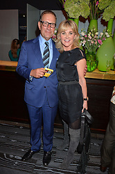 ANTHEA TURNER and RICHARD DESMOND at a party to celebrate the 21st anniversary of The Roar Group hosted by Jonathan Shalit held at Avenue, 9 St.James's Street, London on 21st September 2015.