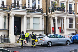 Firefighters still on the scene return with coffee for their colleagues after a fire in a flat on the first floor of a converted house claims the life of a man and his dog in Holland Park, West London. February 07 2018.