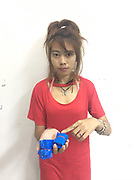 "female drug dealer caught with drugs in bra<br /> <br /> Police arrested three Thai women after they were found to be in possession of a various amounts of methamphetamine pills (ya bah).<br /> <br /> Maj Ritthichai Chumchuay together with a team of officers from Phuket Provincial Police Station first apprehended 24-year-old Paramee (Pa) Songsan from Trang, at 9pm on Thursday at the Phuket Bus Terminal 2 on Thepkassatri Rd in Rassada.<br /> <br /> Paramee arrived on the island on a bus travelling from Satun when she was found to be in possession of 1,000 ya bah pills. Paramee confessed that all the pills belonged to her and she told police that she brought them from a man named only as Mr Den in Trang.<br /> <br /> She travelled to Phuket in the hope of selling the pills here.<br /> <br /> The arrest of Pareemee then led police to arrest two other women.<br /> <br /> At 11pm on Thursday police arrested 24-years-old Chutharat ""Am"" Raksuwan from Trang at a rented room in Chalong when she was found to be in possession of 612 of ya bah pills.<br /> <br /> Chutharat told police that she received the pills from her friend, Paramee, and sold them on her behalf.<br /> <br /> Then at 11pm yesterday police arrested 24-years-old Aungkana 'Kan' Supphakeeratirot also from Trang at the Phuket Bus terminal 2 when she was found in possession of 1,000 ya bah pills.<br /> <br /> The arrest of Aungkana came after Paramee helped police order more drugs from Mr Den.<br /> <br /> Mr Den told Paramee that the drugs would be delivered to her by her friend Aungkana who would travel to Phuket by bus.<br /> <br /> The three women confessed to all charge made against them.<br /> ©Phuket News/Exclusivepix Media"