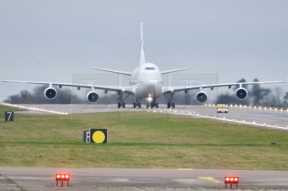 © Licensed to London News Pictures. 31/01/2020. Brize Norton, UK. A plane carrying British Nationals from Wuhan in China to the UK is seen landing at RAF Brize Norton in Oxfordshire. The flight, carrying 83 Britons and 27 foreign nationals from the centre of the coronavirus outbreak, was initially delayed because of a lack of clearance by Chinese Authorities. Photo credit: Ben Cawthra/LNP