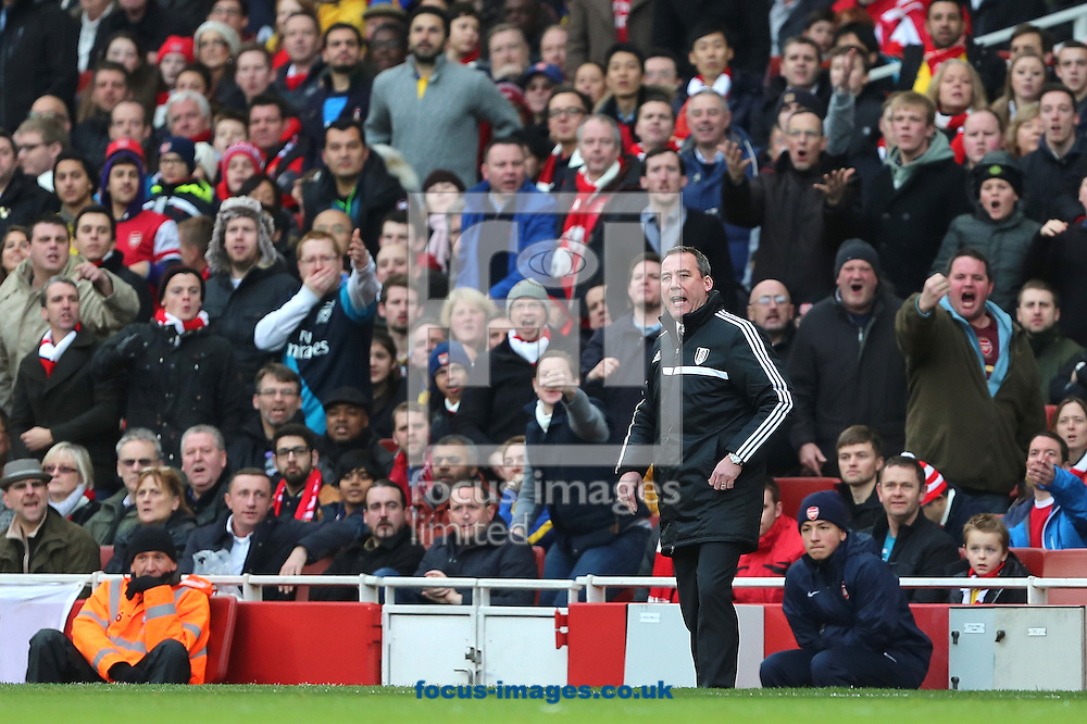 Picture by Richard Calver/Focus Images Ltd +447792 981244<br /> 18/01/2014<br /> Manager of Fulham, Rene Meulensteen cannot hide his frustration in front of unhappy Arsenal fans during the Barclays Premier League match at the Emirates Stadium, London.