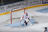 KELOWNA, CANADA - OCTOBER 16: Corbin Boes #1 of the Lethbridge Hurricanes defends the net against the Kelowna Rockets on October 16, 2013 at Prospera Place in Kelowna, British Columbia, Canada.   (Photo by Marissa Baecker/Shoot the Breeze)  ***  Local Caption  ***