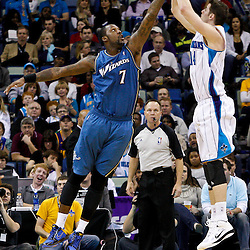 February 1, 2011; New Orleans, LA, USA; New Orleans Hornets power forward Jason Smith (14) shoots over Washington Wizards power forward Andray Blatche (7) during the third quarter at the New Orleans Arena. The Hornets defeated the Wizards 97-89.  Mandatory Credit: Derick E. Hingle