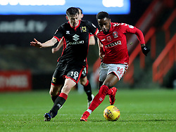 Charlton Athletics Tariqe Foso (Right) and Milton Keynes Dons Conor McGrandles during the Sky Bet League One match at The Valley, Charlton.