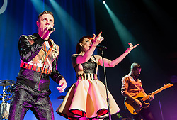 © Licensed to London News Pictures. 23/10/2012. London, UK.   Jake Shears (Left) and Ana Matronic (Centre) of Scissor Sisters performing live at Camden Roundhouse. Scissor Sisters are an American band formed in 2001.  The band took their name from a sexual position between two women also known as tribadism.  Its members comprise Jake Shears and Ana Matronic as vocalists, Babydaddy as multi-instrumentalist, Del Marquis as lead guitar/bassist, and Randy Real as drummer. Scissor Sisters have incorporated diverse and innovative styles in their music, but tend to sway towards pop rock, glam rock, nu-disco, and electroclash.  Photo credit : Richard Isaac/LNP
