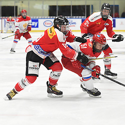 WHITBY, - Dec 15, 2015 -  WJAC Game 6- Team Russia vs Team Switzerland at the 2015 World Junior A Challenge at the Iroquois Park Recreation Complex, ON. Yannick Lerch #18 of Team Switzerland battles for control with Nikolay Kovalenko #51 of Team Russia during the third period.(Photo: Andy Corneau / OJHL Images)