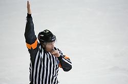 Pisk. Slovenski hokejski sodnik Damir Rakovic predstavlja sodniske znake. Na Bledu, 15. marec 2009. (Photo by Vid Ponikvar / Sportida)