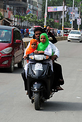 August 15, 2017 - Allahabad, Uttar Pradesh, India - Allahabad: A muslim drive scooty as his daughter wear tricolor on the occasion of Independence Day celebration in Allahabad on 15-08-2017. (Credit Image: © Prabhat Kumar Verma via ZUMA Wire)