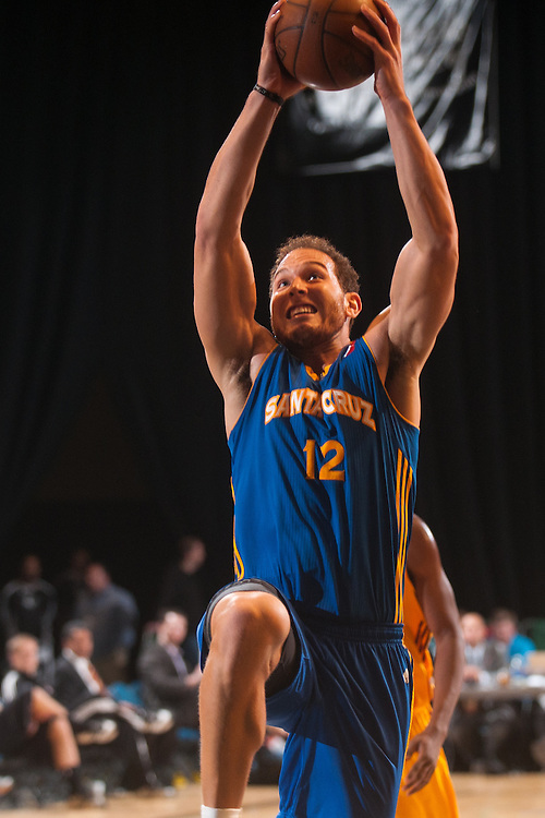 RENO, NV - JANUARY 10:  Taylor Griffin #12 of the Santa Cruz Warriors dunks against the Canton Charge during the 2013 NBA D-League Showcase on January 10, 2013 at the Reno Events Center in Reno, Nevada.  NOTE TO USER: User expressly acknowledges and agrees that, by downloading and/or using this photograph, User is consenting to the terms and conditions of the Getty Images License Agreement.  Mandatory Copyright Notice: Copyright 2013 NBAE (Photo by David Calvert/NBAE via Getty Images) *** Local Caption *** Taylor Griffin