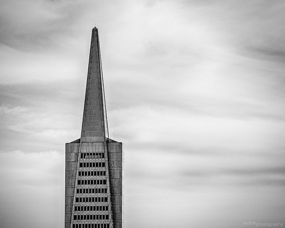 Top floors and spire of the Transamerica Building as seen from the top of Coit Tower in San Francisco, CA. (black and white)