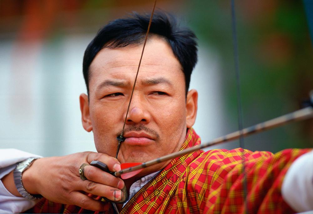 Archer taking aim during archery festival, Paro, Bhutan