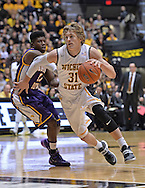 WICHITA, KS - JANUARY 05:  Guard Ron Baker #31 of the Wichita State Shockers drives by guard Wes Washpun #11 of the Northern Iowa Panthers during the first half on January 5, 2014 at Charles Koch Arena in Wichita, Kansas.  (Photo by Peter Aiken/Getty Images) *** Local Caption *** Ron Baker;Wes Washpun