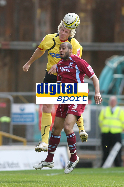 Photo: Pete Lorence/Richard Lane Photography. <br />Watford v Scunthorpe United. Coca-Cola Championship. 26/04/2008. <br />Darius Henderson leaps over Marcus Williams.