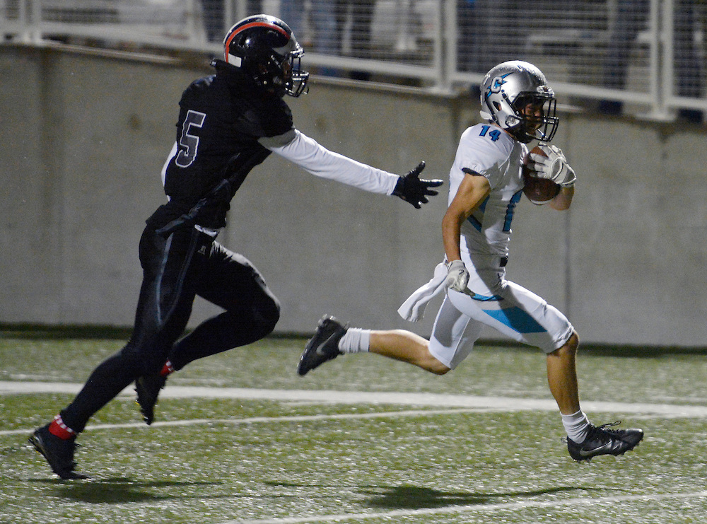 gbs110416dd/SPORTS -- Cleveland's Antonio Lovato, 14, outruns Volcano Vista's Michael Valdez, 5, for a touchdown during the game in Community Stadium on Friday, November 4, 2016. (Greg Sorber/Albuquerque Journal)