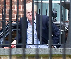 © Licensed to London News Pictures. 12/08/2019. London, UK. Prime Minister Boris Johnson arrive at the back of Downing Street. Later today the Prime Minister will host senior police, justice and probation officials . Photo credit: George Cracknell Wright/LNP