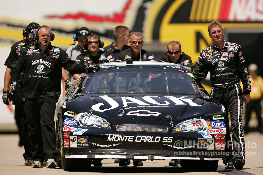 Clint Bowyer walks with his car and crew back to the garage area following practice for the Allstate 400 at the Brickyard on August 5, 2006.