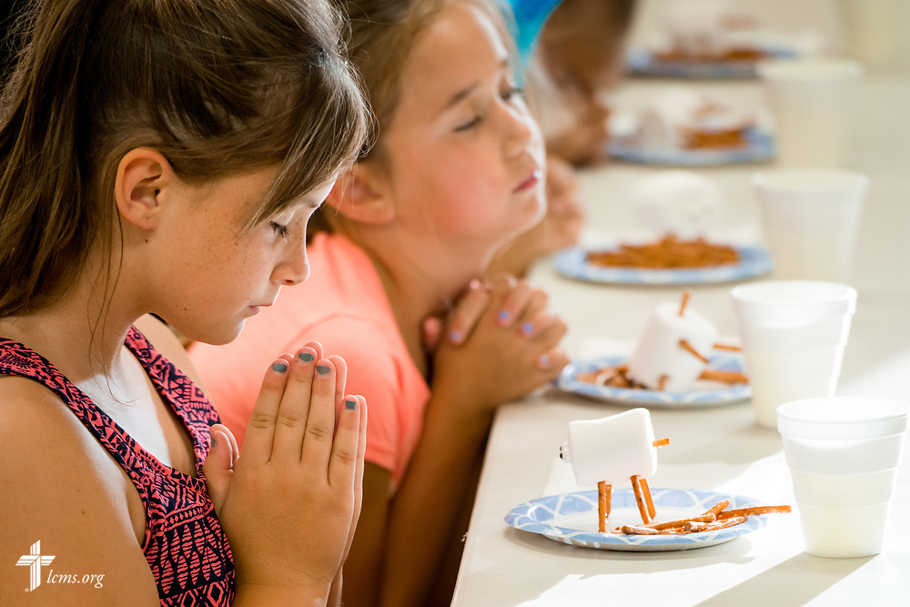 Camp Courage VBS campers pray before a snack at Zion Lutheran Church on Thursday, July 13, 2017, in Ottawa, Ill. The VBS resource is available from LCMS Disaster Response.  LCMS Communications/Erik M. Lunsford