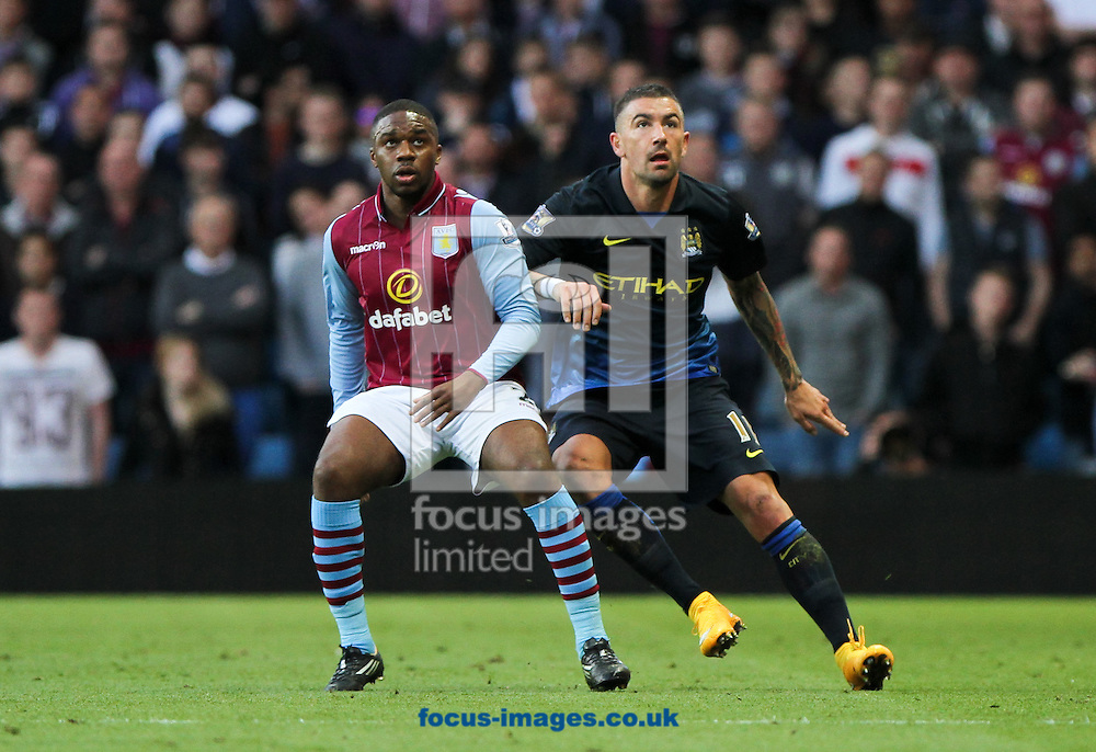 Charles N'Zogbia (left) of Aston Villa and Aleksandar Kolarov (right) of Manchester City during the Barclays Premier League match at Villa Park, Birmingham<br /> Picture by Tom Smith/Focus Images Ltd 07545141164<br /> 04/10/2014